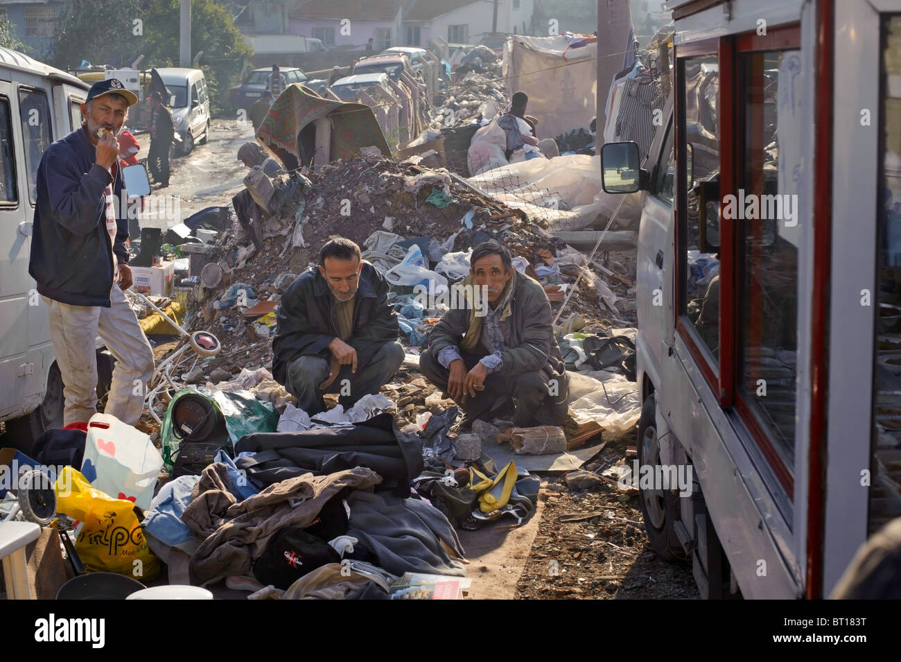 Potential customers peruse the goods at a stall in the Izmir flea market. - Stock Image