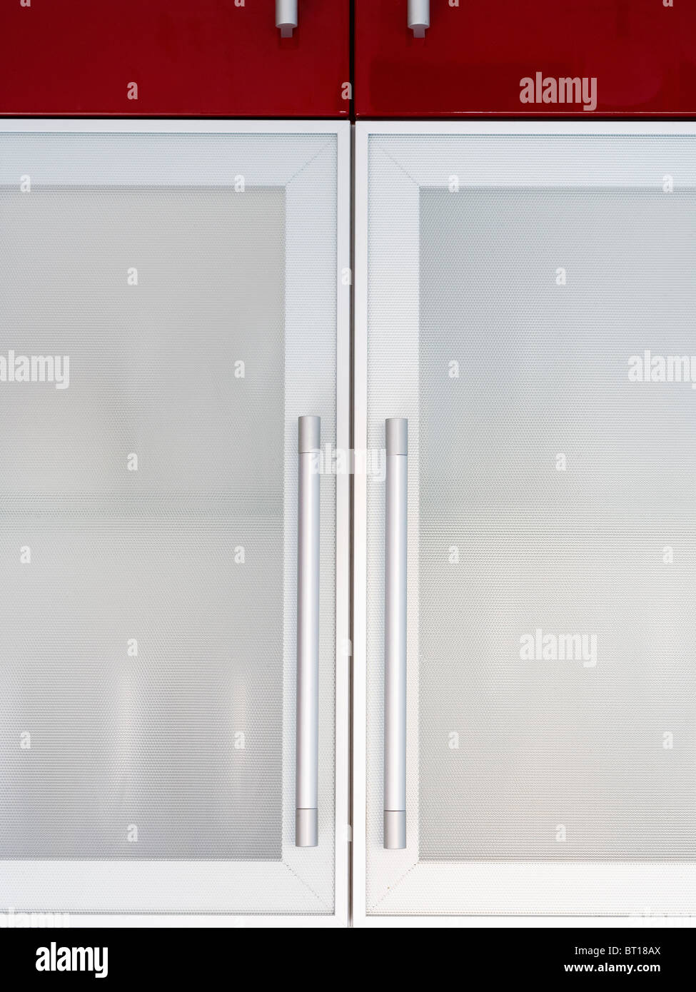 Ante Cucina In Vetro.Close Up Of Kitchen Cupboard With Opaque Glass Doors With Steel