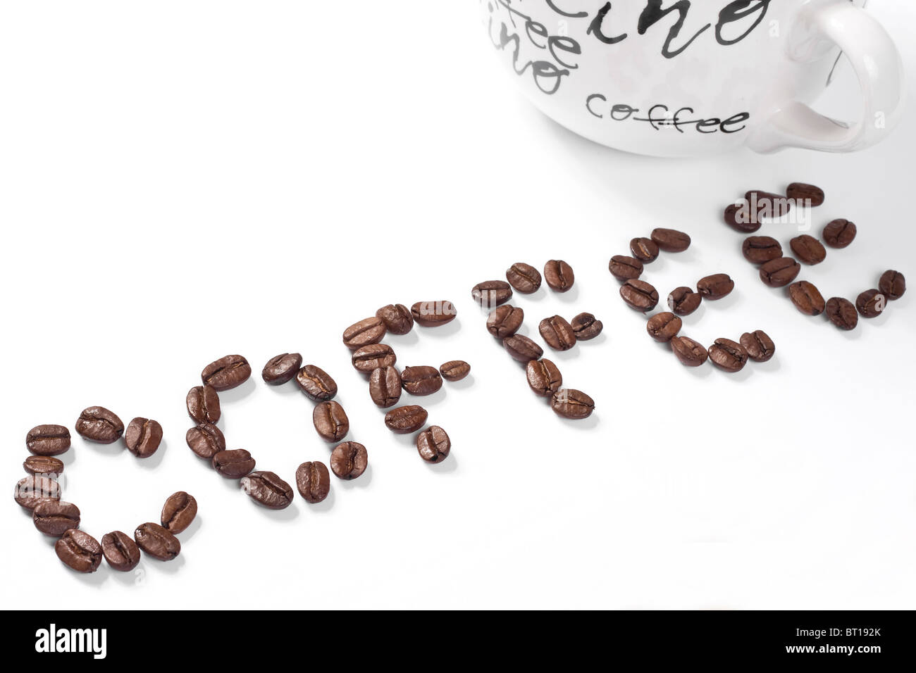 A cup of coffee and coffee beans Stock Photo