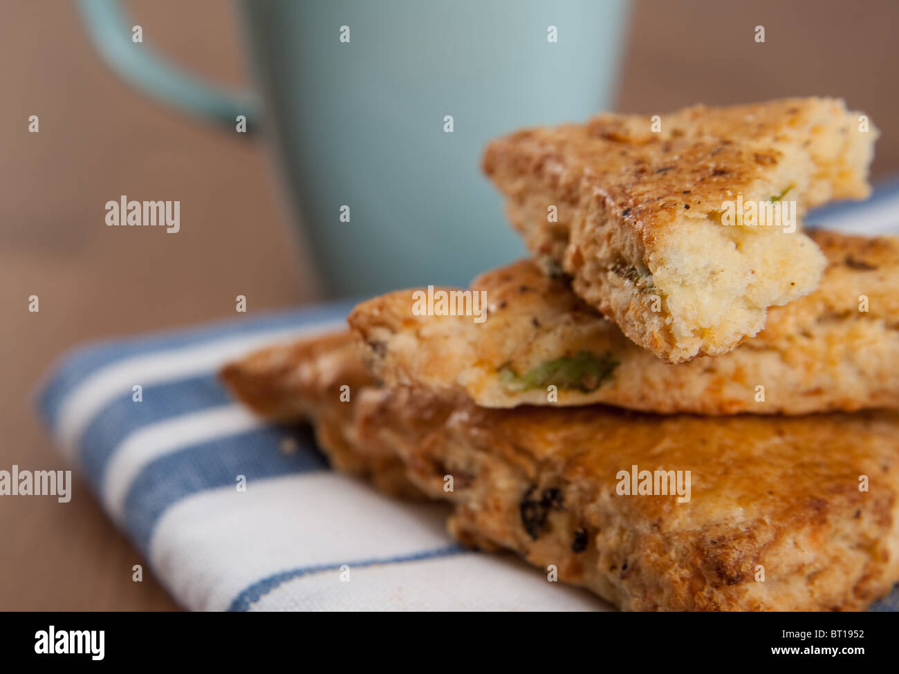 Savory Scones with Cup of Coffee or Tea for Breakfast - Stock Image
