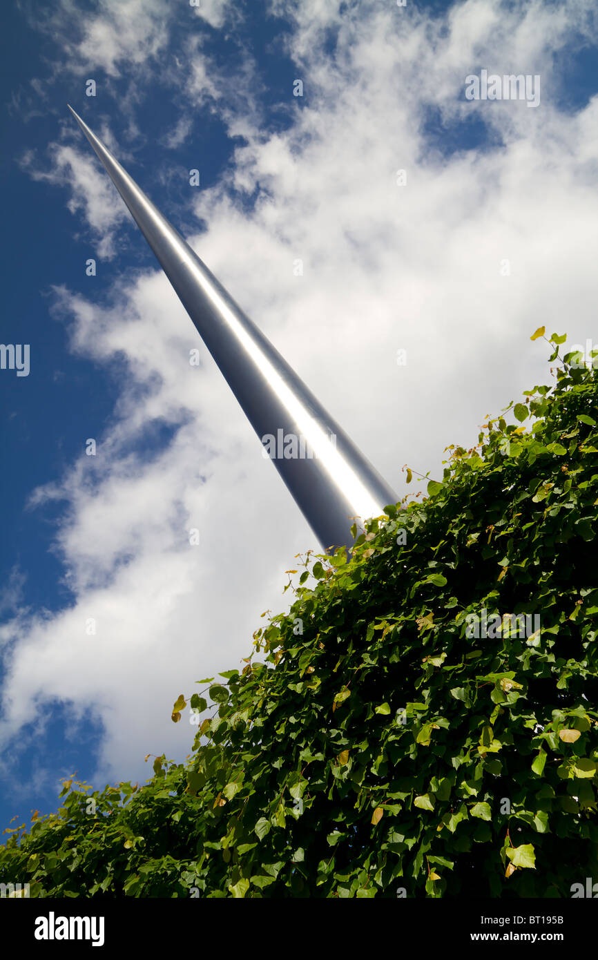 Shot of Dublin Spire over a tree. - Stock Image