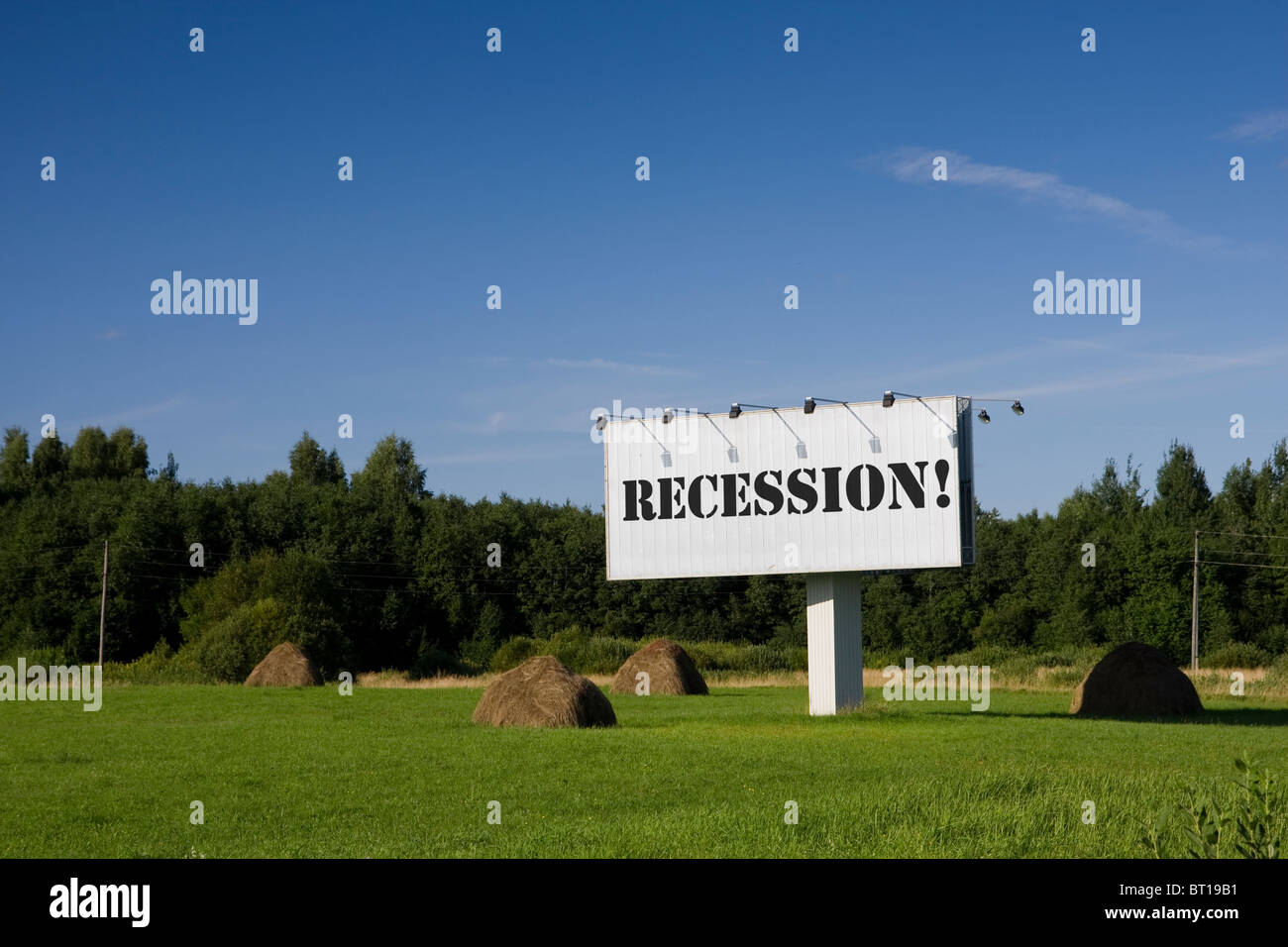 Billboard in a field with a word Recession on it. - Stock Image