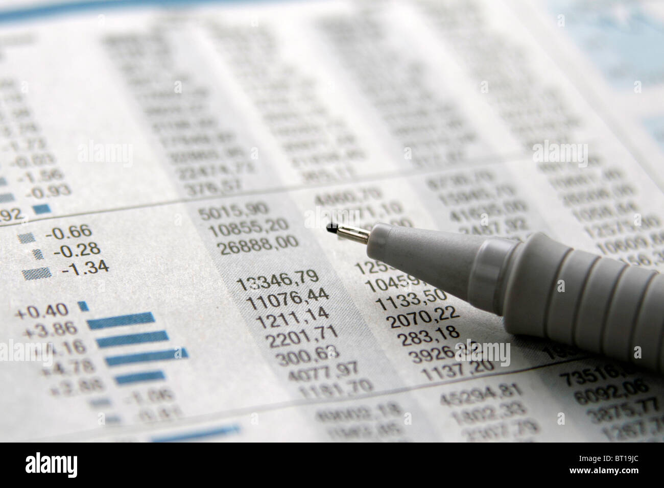 newspaper stock information marked with pencil - Stock Image