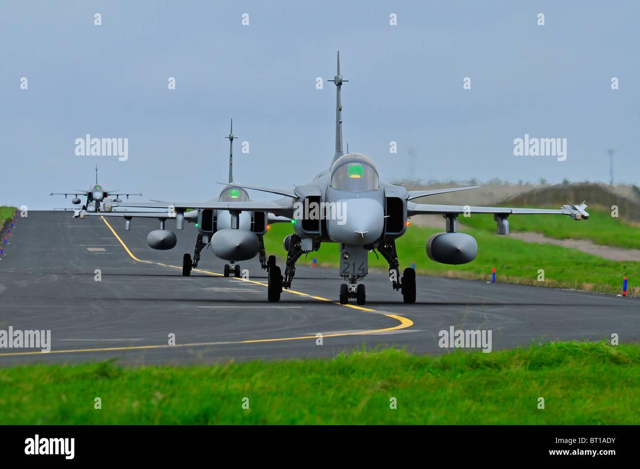 Saab JAS 39 Gripens single engined fast military Swedish jet fighter aircraft.  SCO 6851 Stock Photo