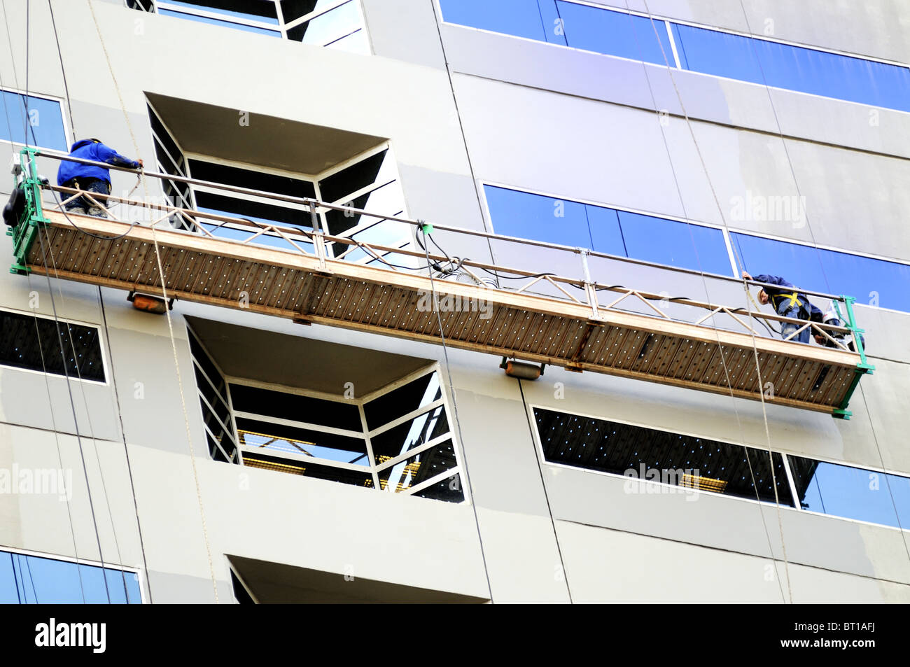 Window washers working in Fort Wayne Indiana - Stock Image
