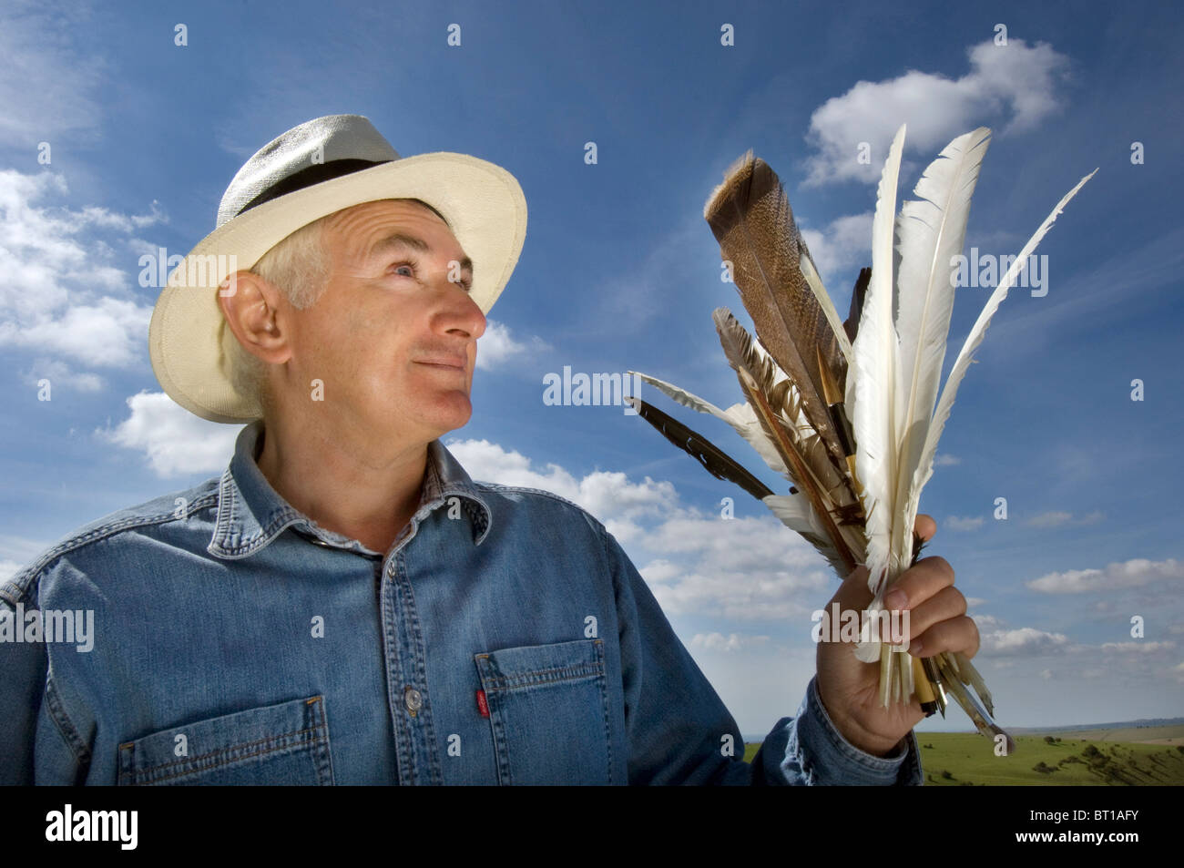 Calligrapher Ewan Clayton with feathered quills he uses to recreate ancient writing skills . - Stock Image