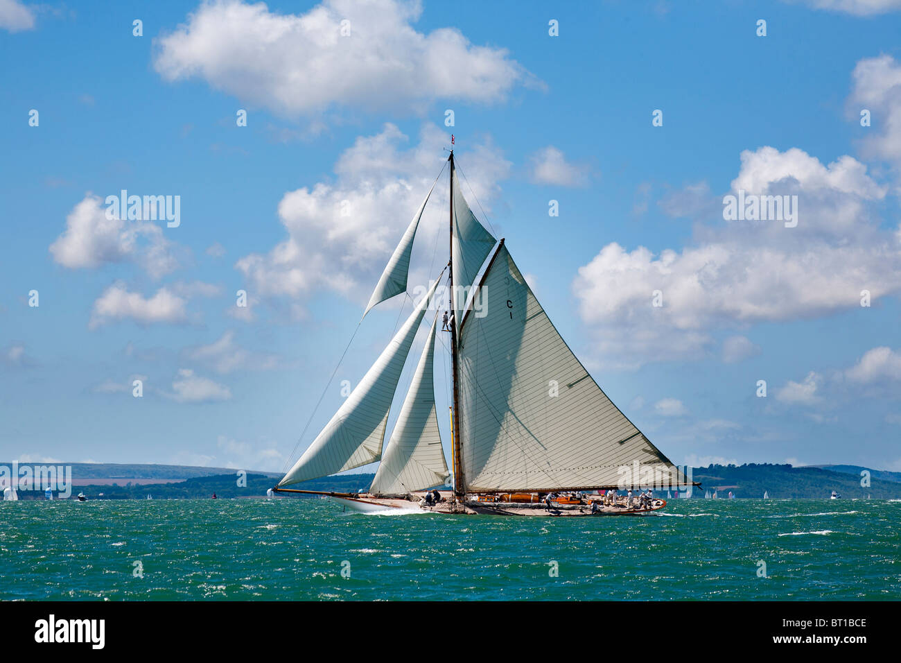 19-metre traditional gaff cutter Mariqita sailing yacht under full sail in the Solent sail number C1 built in 1911 - Stock Image