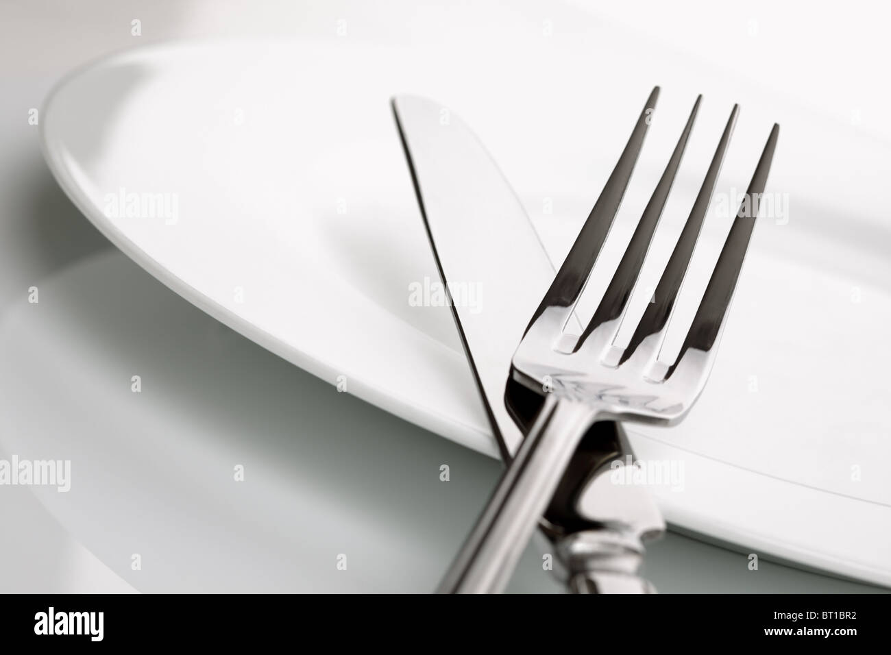 Dinner plate, knife and fork silverware - Stock Image