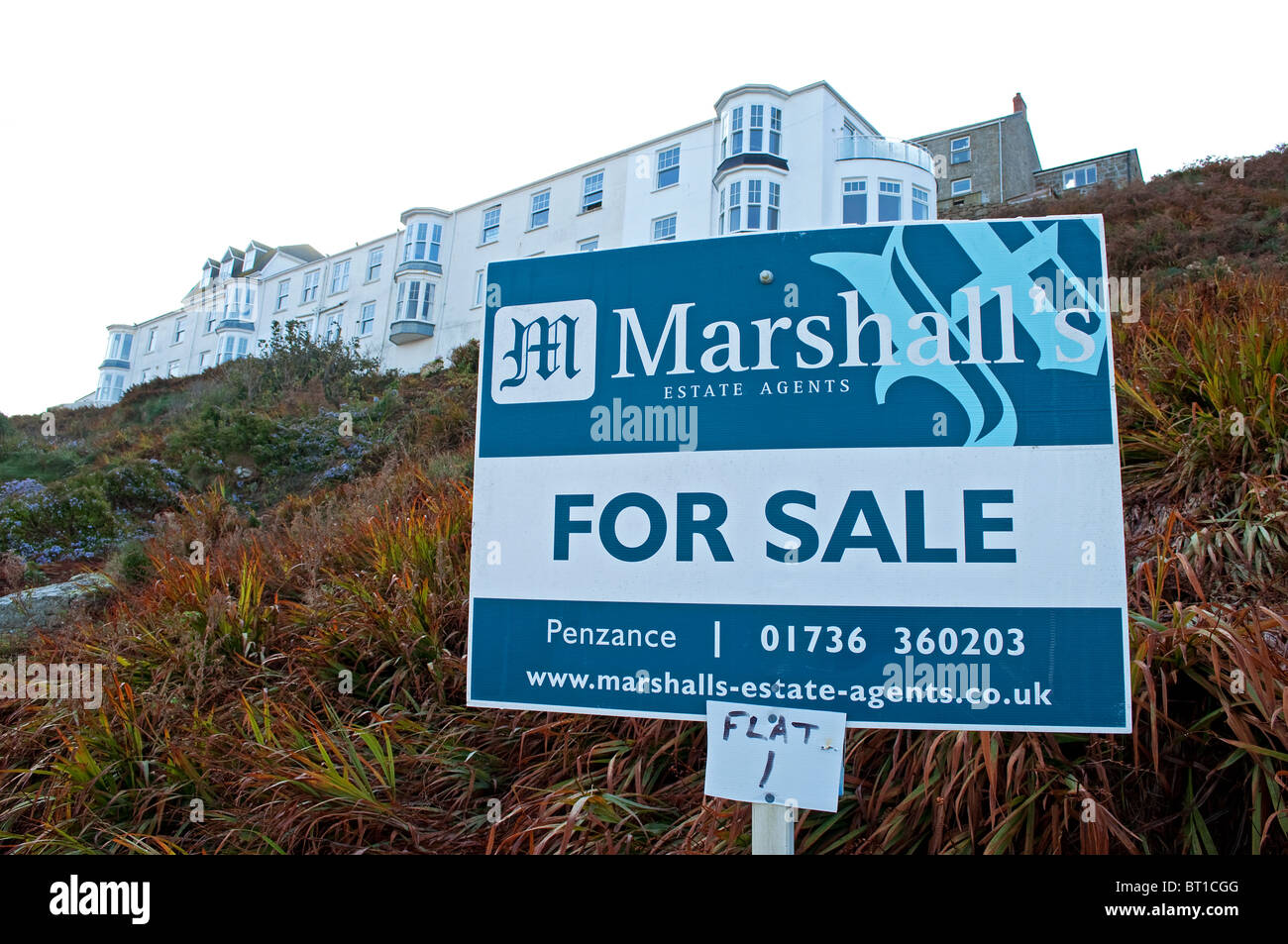a flat for sale sign at sennen cove in cornwall, uk - Stock Image