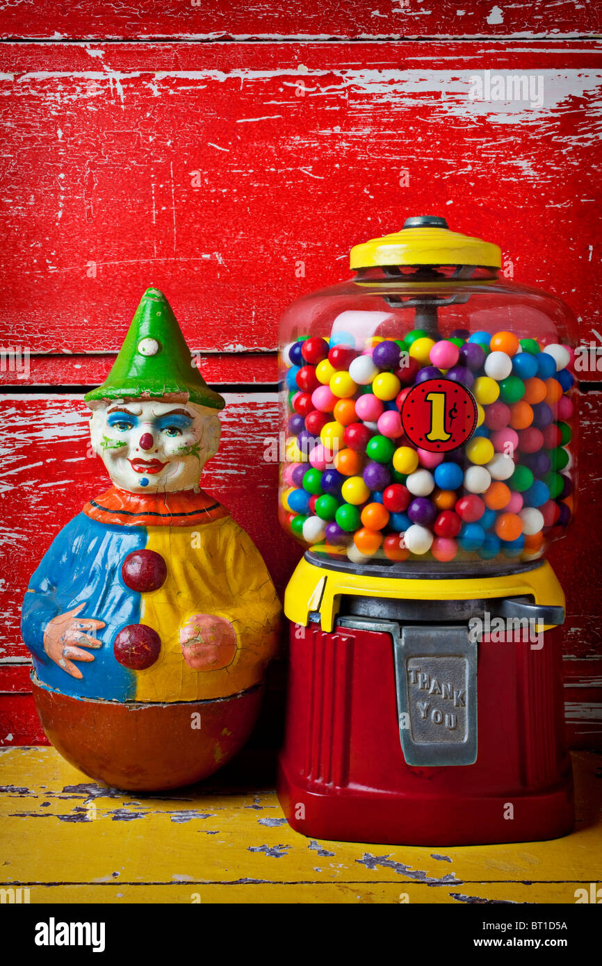 Old clown toy and gum machine Stock Photo