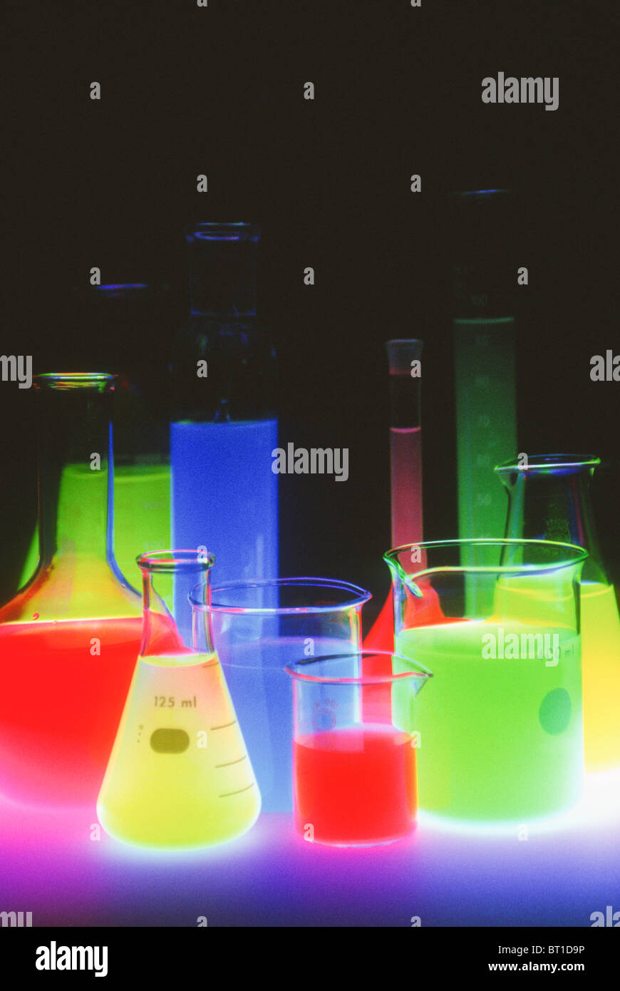group of dayglo laboratory beakers Stock Photo