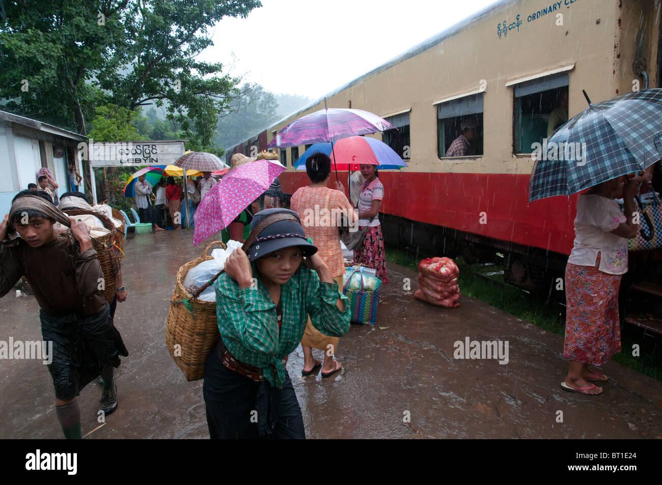 On a Platform under Monsoon Rain in Lebyin Train Station on the Thazi to Shwenyaung train line. Myanmar - Stock Image