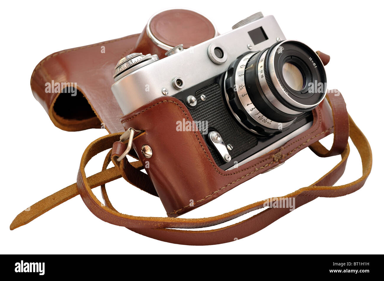 Isolated used vintage film photo-camera in leather case - Stock Image