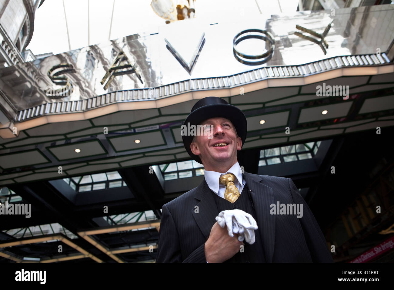 Savoy Hotel in London. Reopened in October 2010 after a complete refurbishment. Photos show the doorman outside - Stock Image