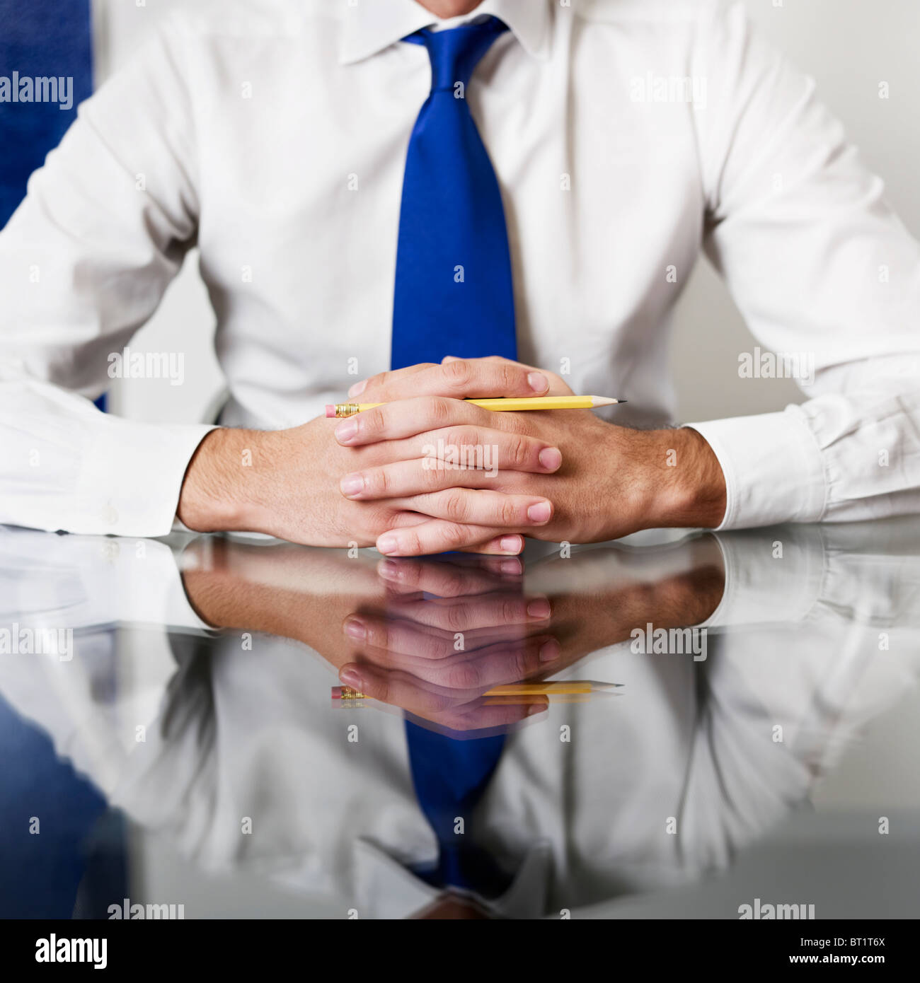 businessman with hands clasped. - Stock Image