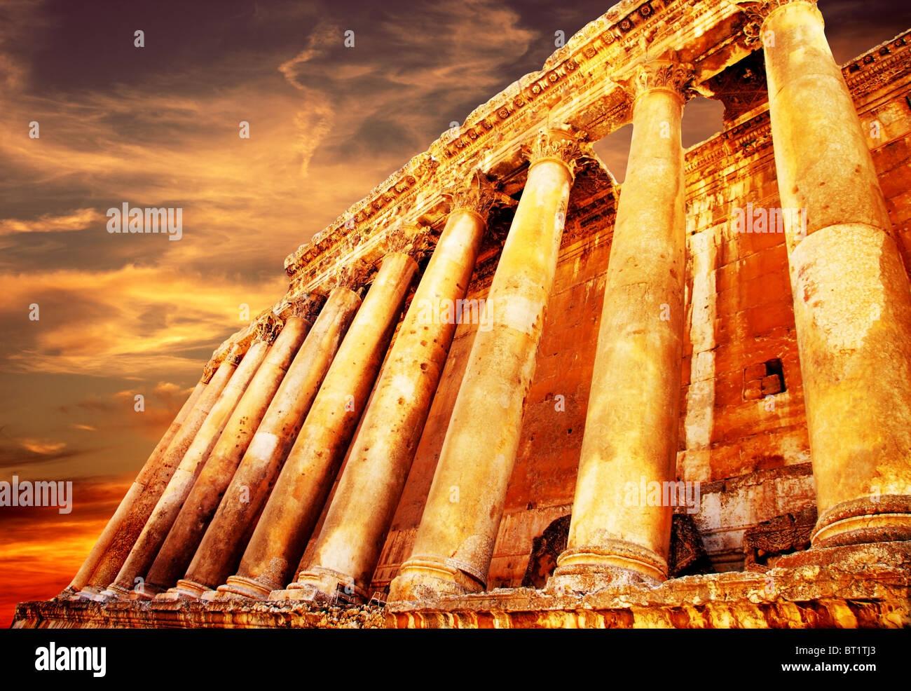 Jupiter's temple ancient Roman columns over sunset, Baalbek, Lebanon - Stock Image