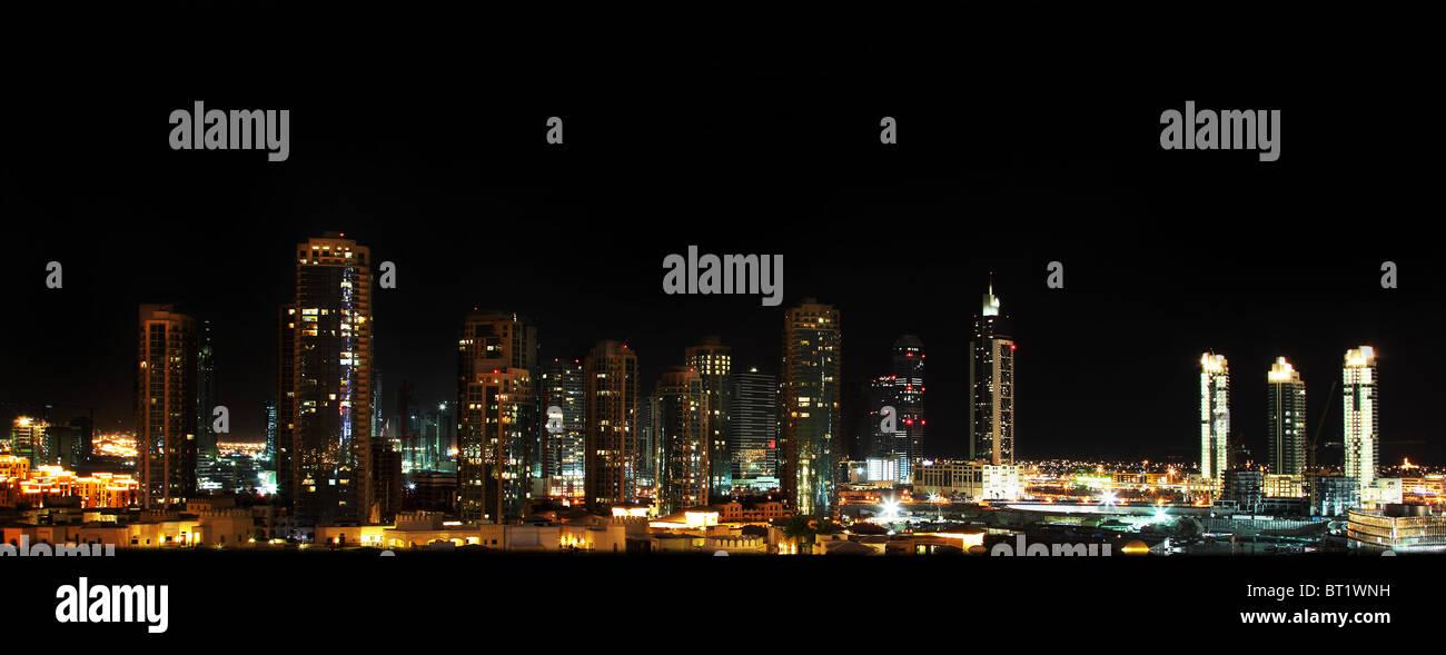 panoramic shot of Dubai downtown at night - Stock Image