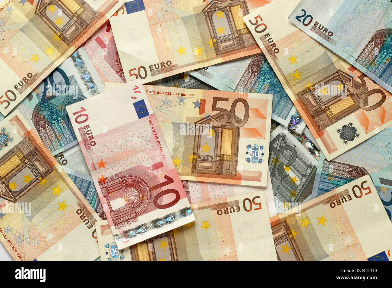 Lots of various Euro cash notes covering the photo. - Stock Image