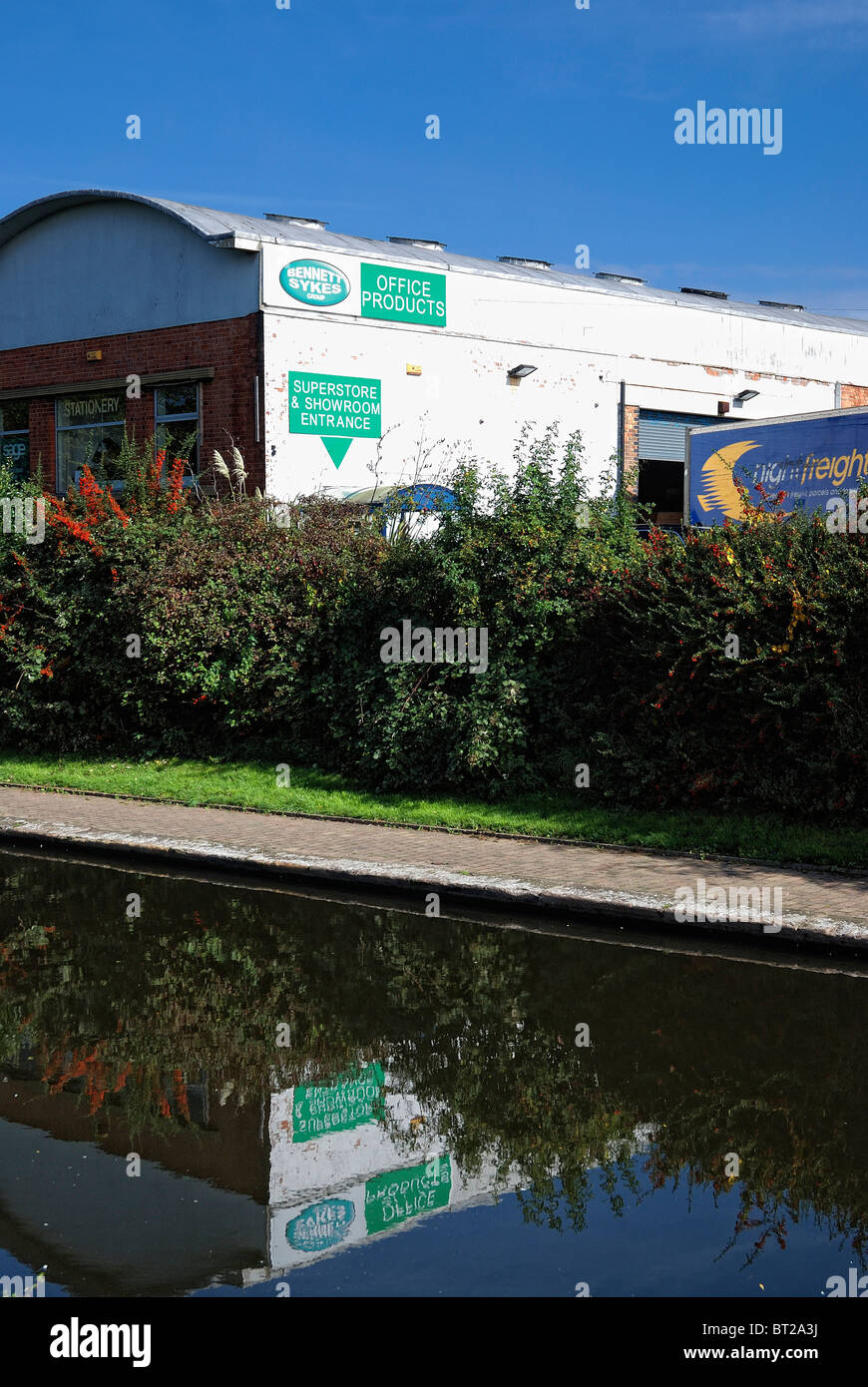 canal reflection sykes bennet office equipment showrooms - Stock Image