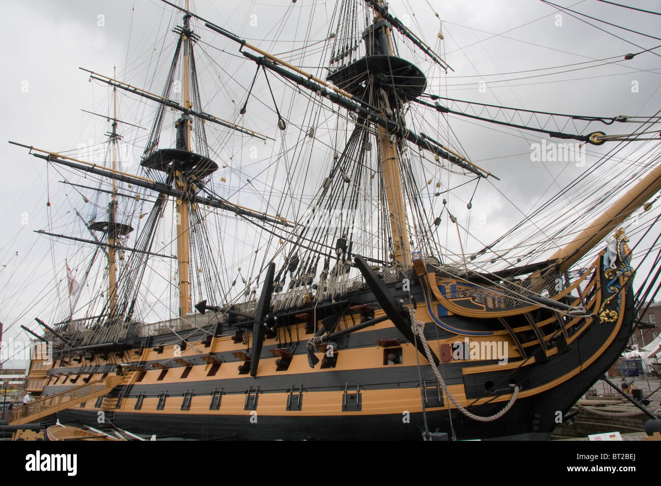 Image of Lord Nelson's flagship HMS Victory at Portsmouth Dockyard in Hampshire - Stock Image