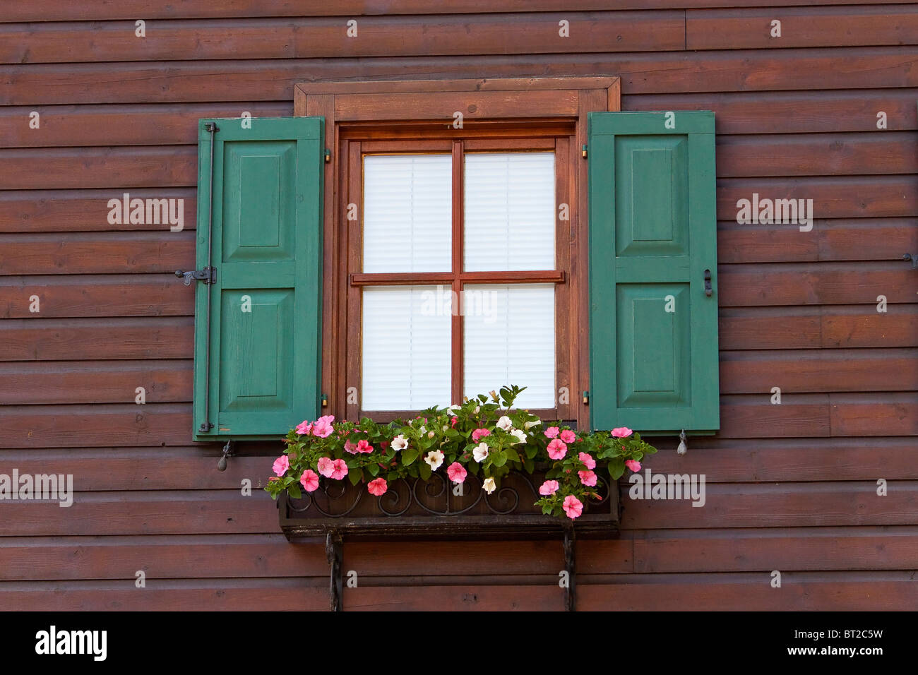 Austria Kitzbuhel Traditional Wood Clad House and Window Stock Photo