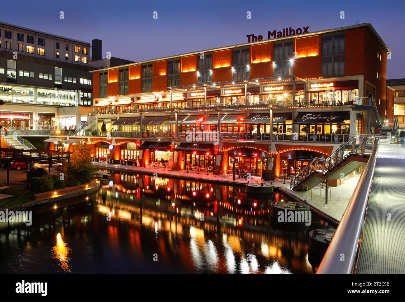 The Mailbox development at night, showing bars and restaurants along the canal. Birmingham, West Midlands, England, - Stock Image