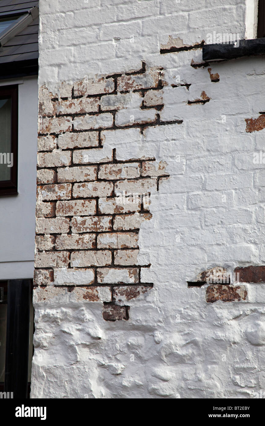 Brickwork in house wall cleaned ready for repointing Wales UK - Stock Image