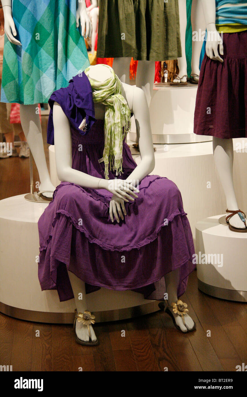 Sitting Mannequin in Shopping Center - Stock Image