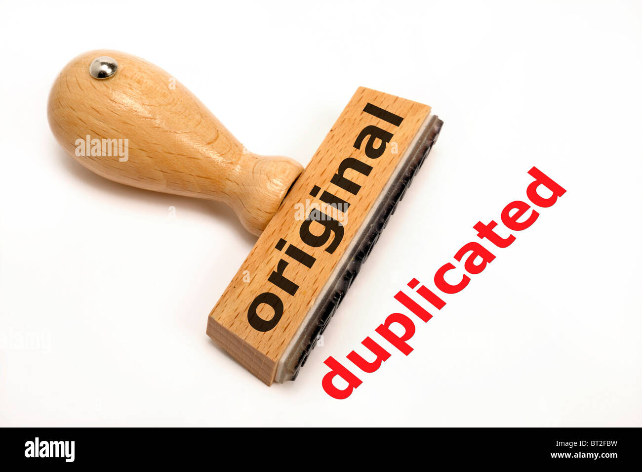 rubber stamp marked with ORIGINAL and its copy DUPLICATED - Stock Image