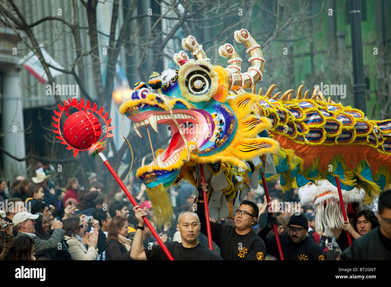 Dragon is carried down Market Street by participants in San Francisco during Chinese New Year parade in Year of - Stock Image