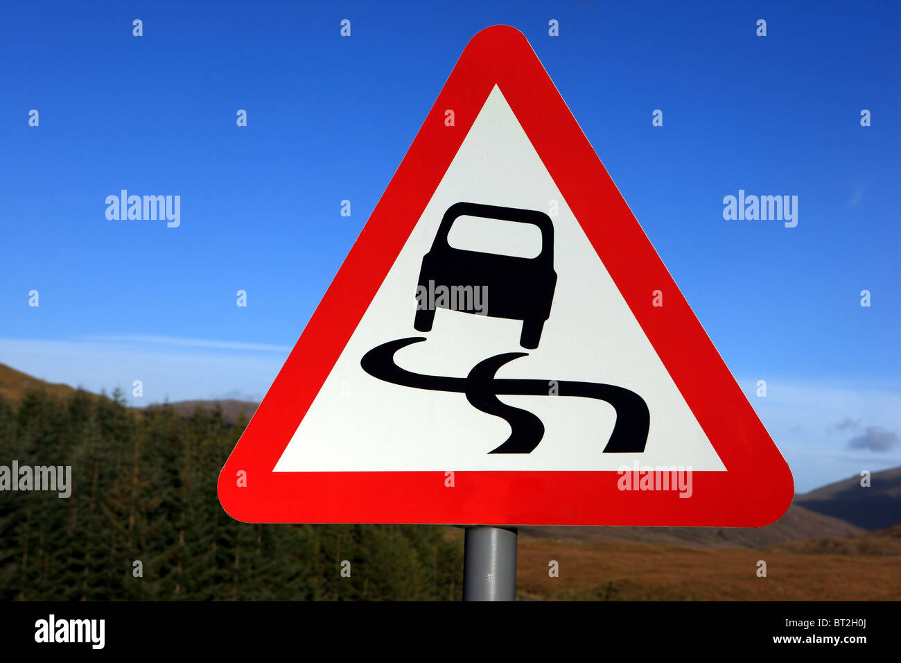 Slippery road sign in the UK - Stock Image