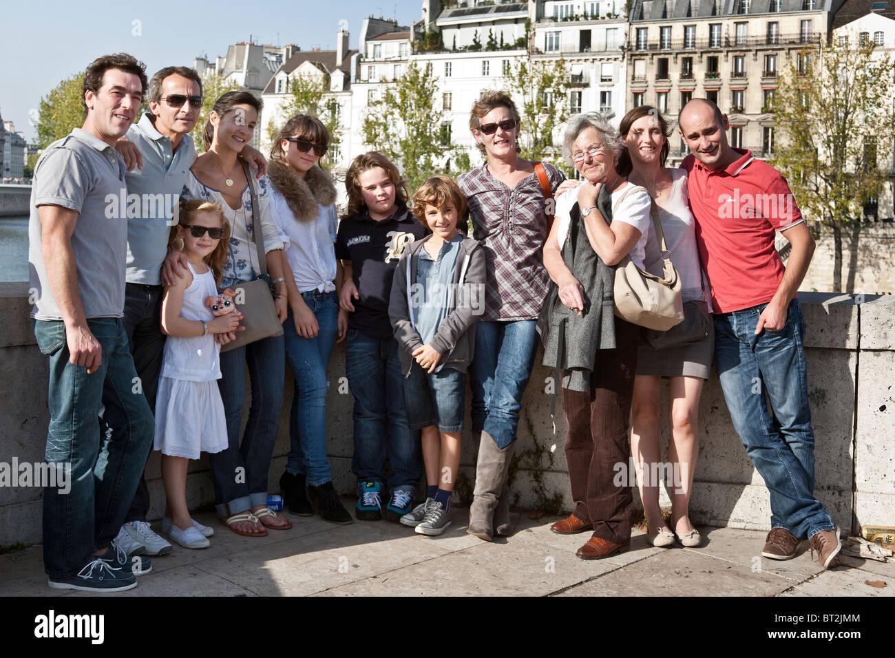 French matriarch poses for family portrait on Pont de la