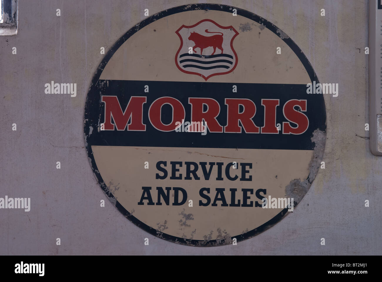 Morris Motors of Cowley sales and service sign on the wall of a derelict garage - Stock Image