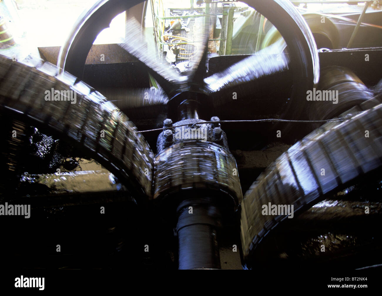 Old Gear Machine, oiled up and used for rum production. - Stock Image
