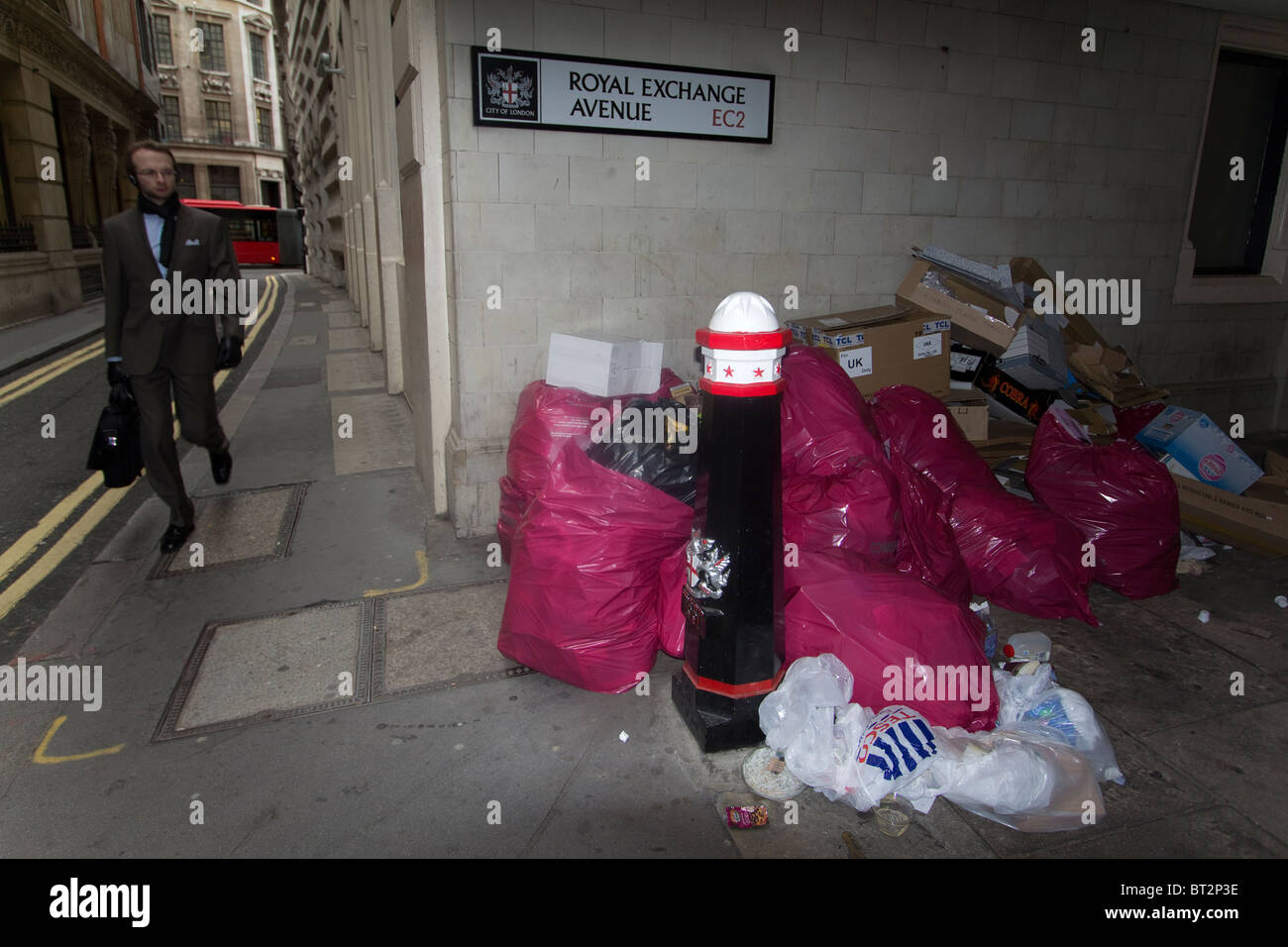 Rubbish piled up in the city of London, bags of trash litter Royal exchange avenue - Stock Image