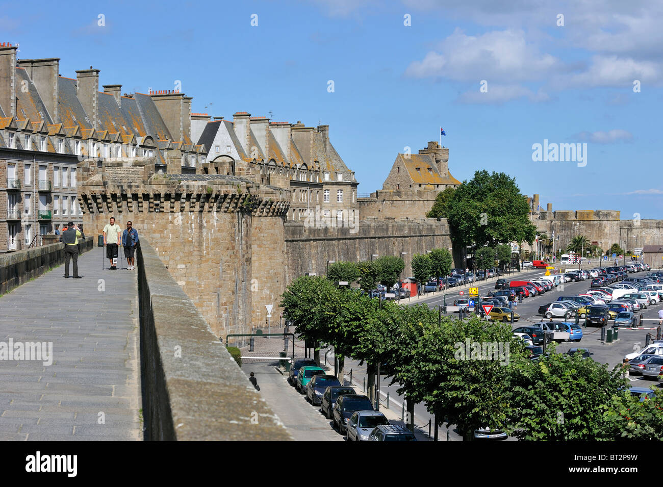 Tourists walking on rampart at Saint-Malo, Brittany, France - Stock Image