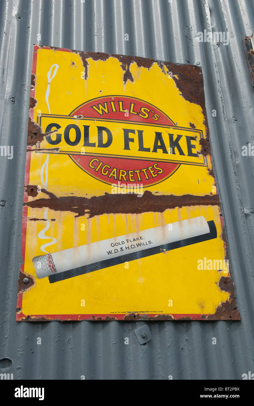 Wills Gold Flake cigarettes sign on derelict building - Stock Image