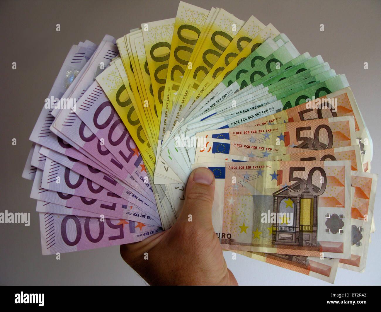 many 500 200 100 50 euro banknotes notes bills - Stock Image