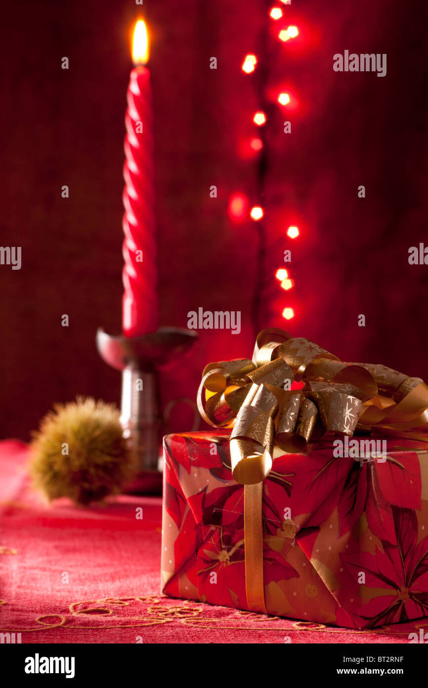 Christmas Present with Candle - Stock Image