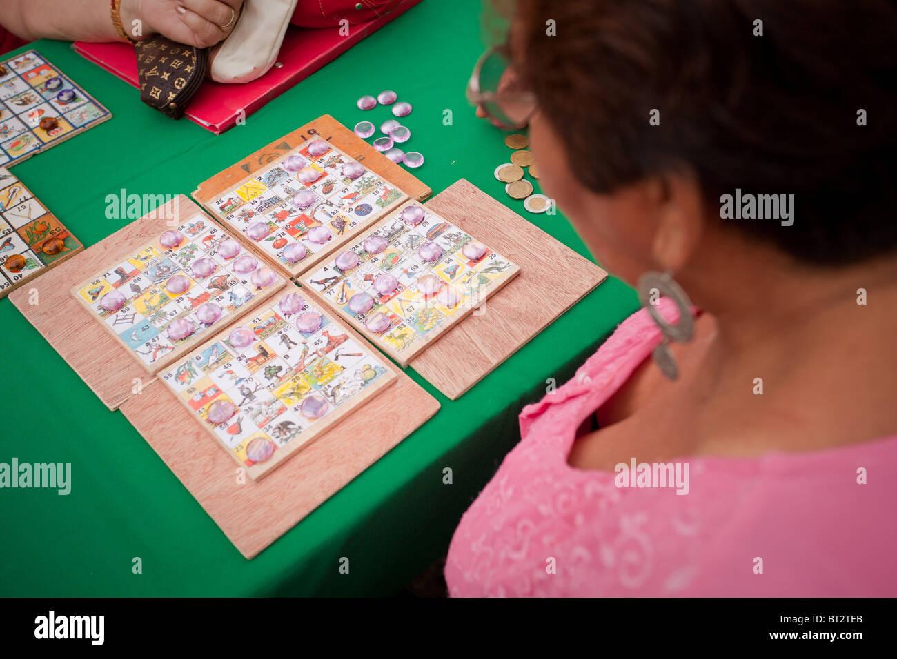 Woman playing bingo campechano during a fair in Campeche, Mexico Stock Photo