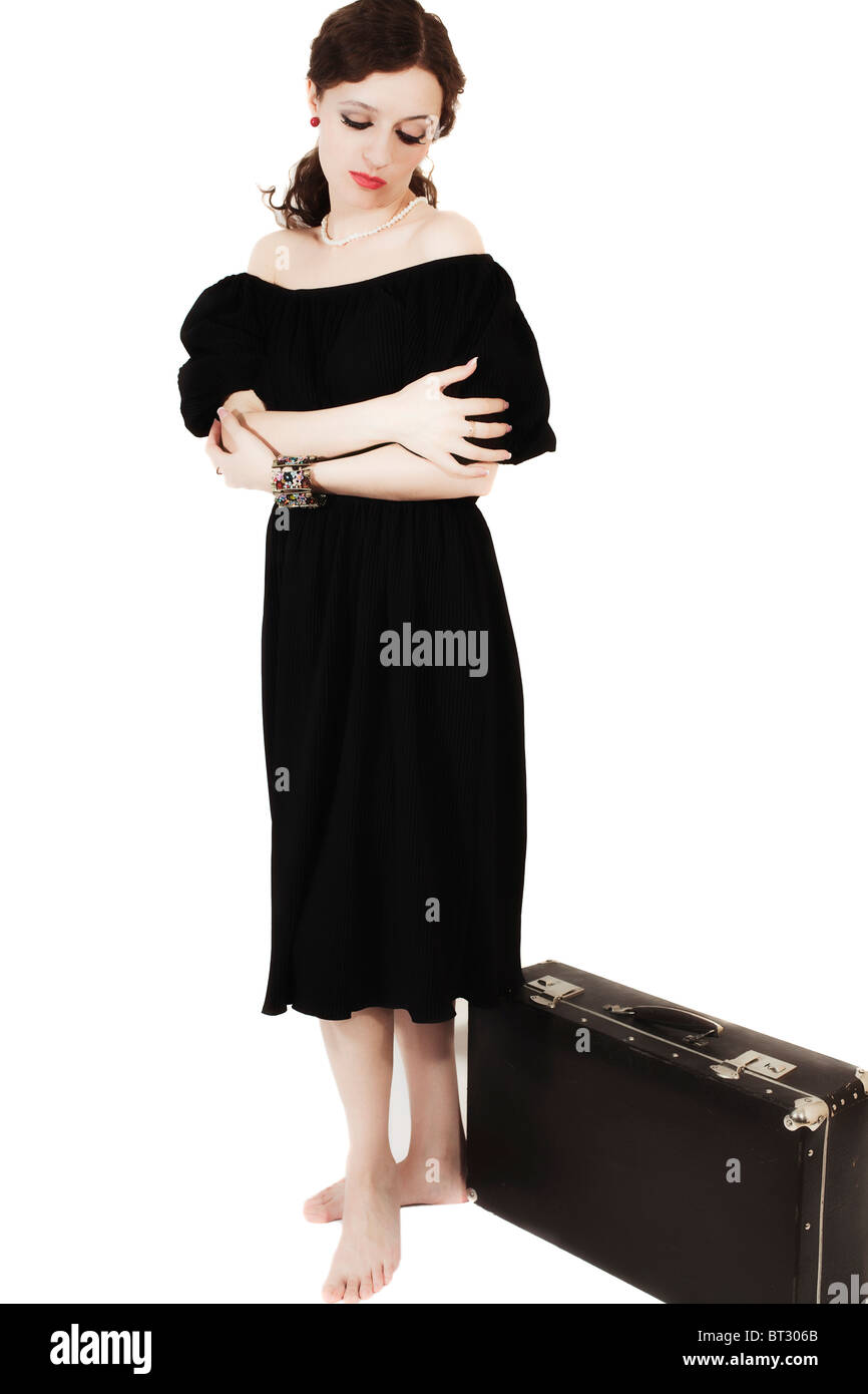 b8c16dd9586 young woman in retro style with old suitcase isolated on white background