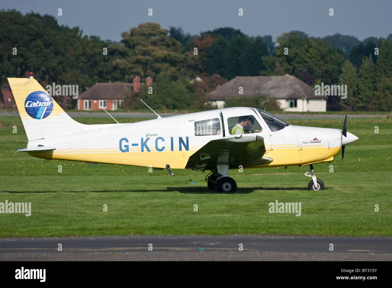 Small single engined aircraft getting ready for take off - Stock Image