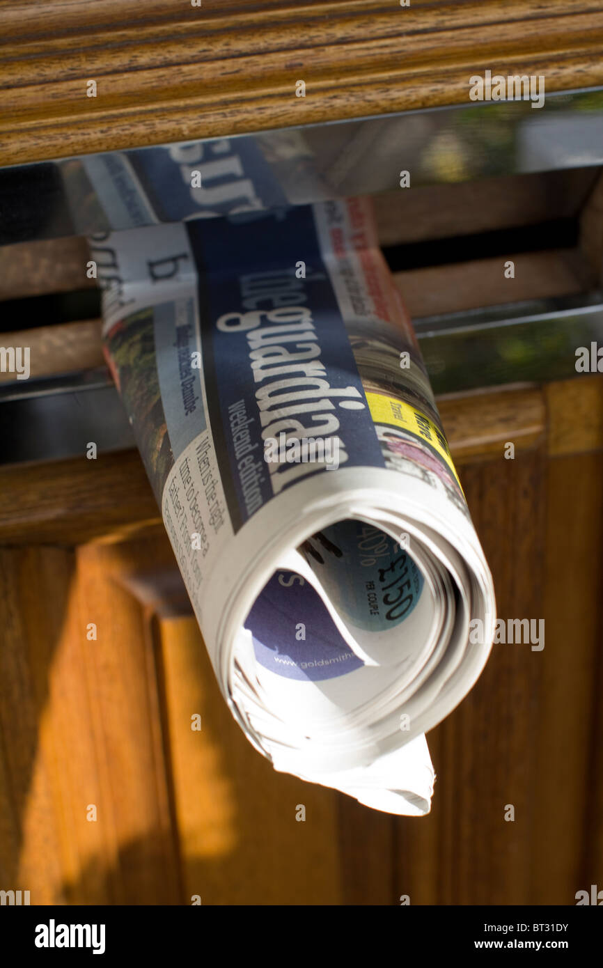 The Guardian Newspaper in Letterbox - Stock Image