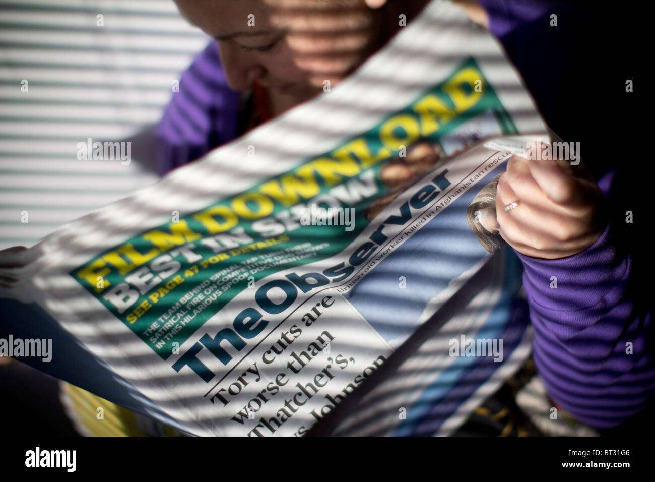 The Observer newspaper reader UK newspaper - Stock Image