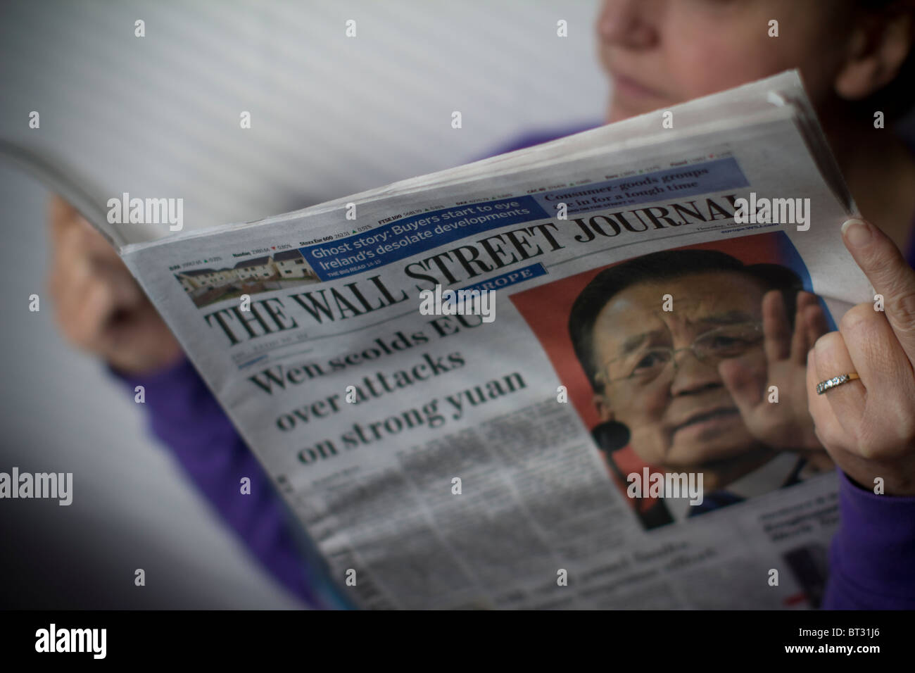 Wall Street journal reader - Stock Image