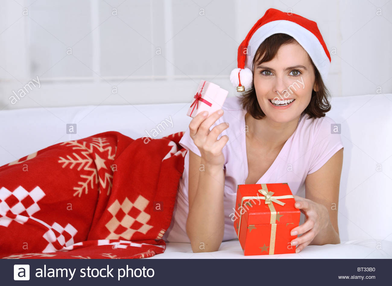 young brunette woman with Christmas presents - Stock Image