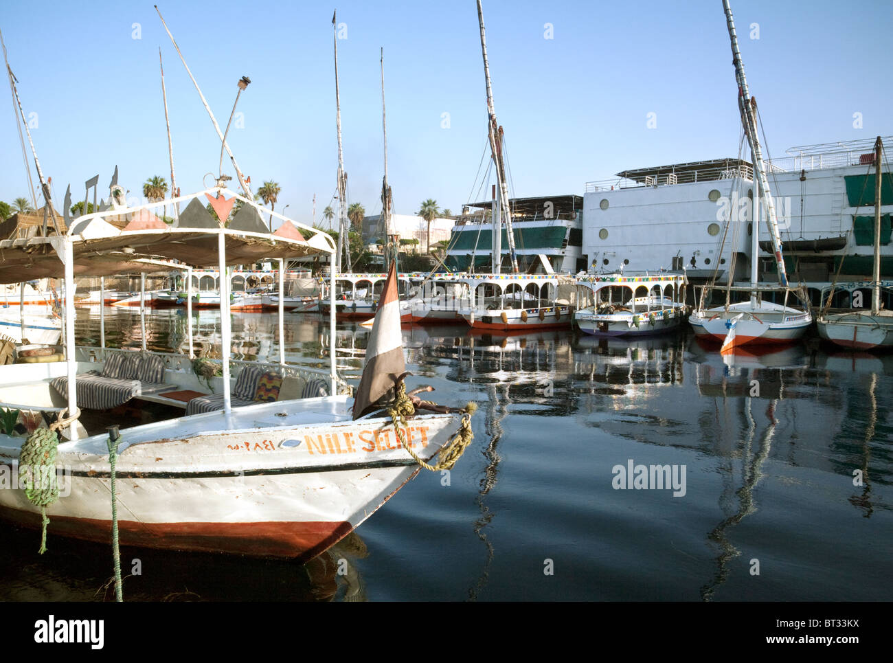 Feluccas tied up in harbour,  the river Nile, Aswan, Upper Egypt - Stock Image