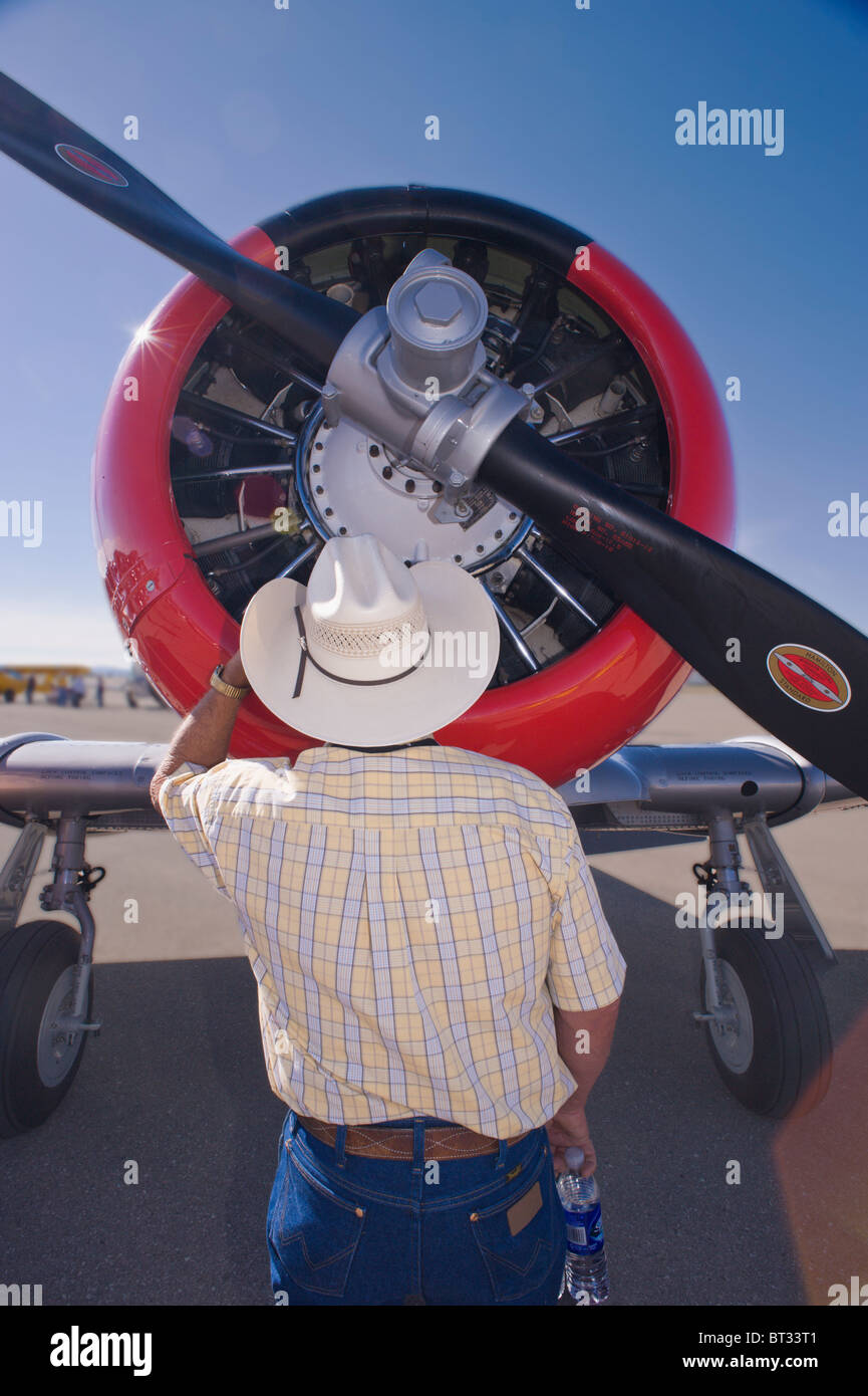 A Texan inspects the radial engine of a North American