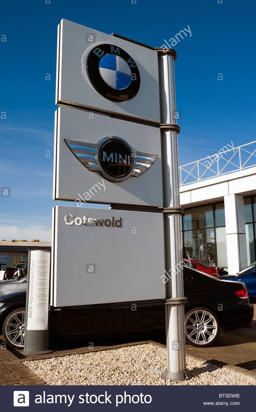 BMW Mini Cotswold car dealership sign in Cheltenham, UK. Car dealers ...