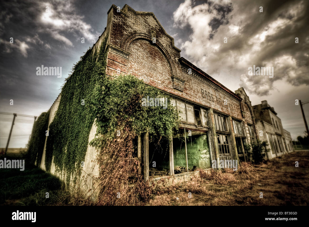 Bass Sales Co. Building in a derelict condition in USA - Stock Image